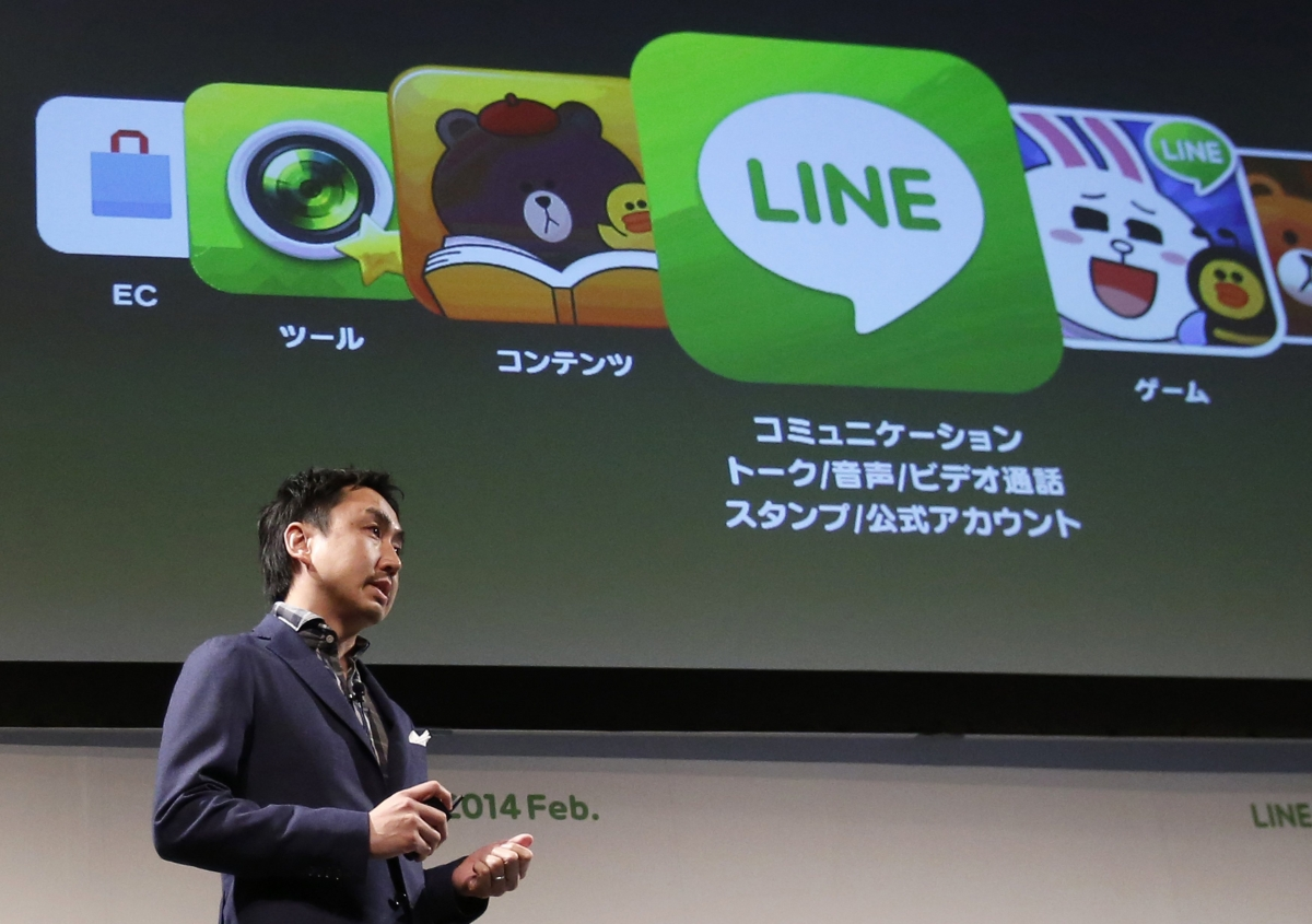 Takeshi Idezawa, chief operating officer of Line Corp, speaks during an announcement of its new service in Tokyo