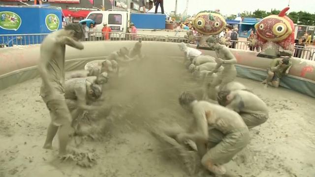 Visitors Get Messy at South Korean Mud Festival