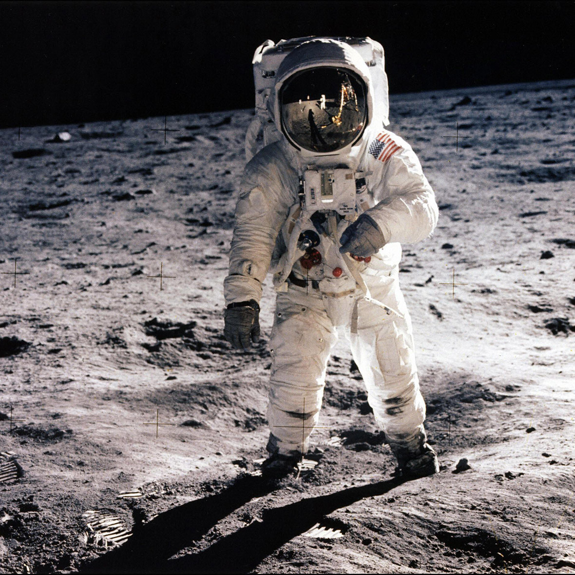 July 20, 1969: Buzz Aldrin walks on the surface of the moon.  Neil  Armstrong, taking the photo,  is reflected in his visor
