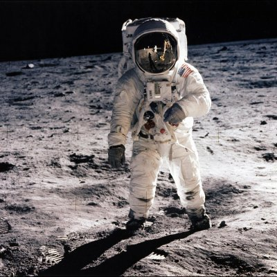 July 20, 1969 Buzz Aldrin walks on the surface of the moon.  Neil  Armstrong, taking the photo,  is reflected in his visor