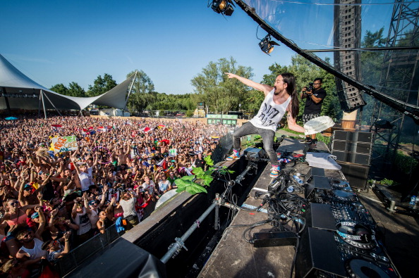 American DJ Steve Aoki throws a cream tart into the crowd during the first day of the Tomorrowland music festival, in Boom, on July 18, 2014.