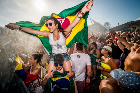 Revellers party during the first day of the Tomorrowland music festival, in Boom, on July 18, 2014.