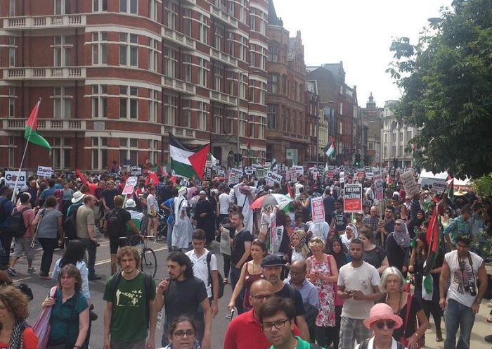 Scores of protesters throng the streets of central London. The march started outside Downing Street and will follow a route to the Israeli embassy in Kensington.