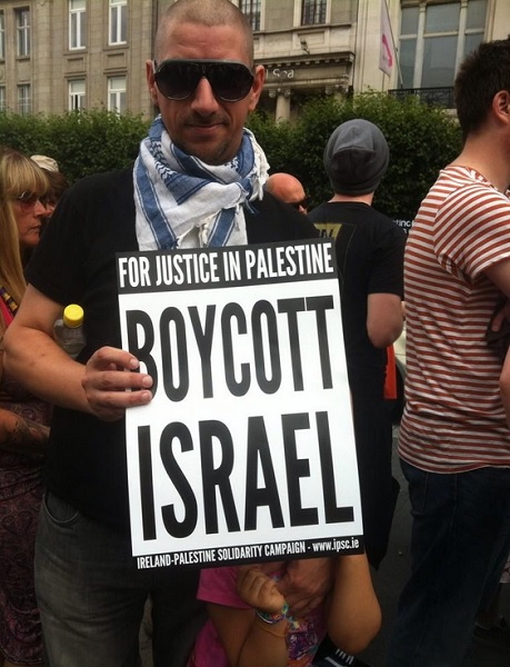 A protester holds an anti-Israel placard.
