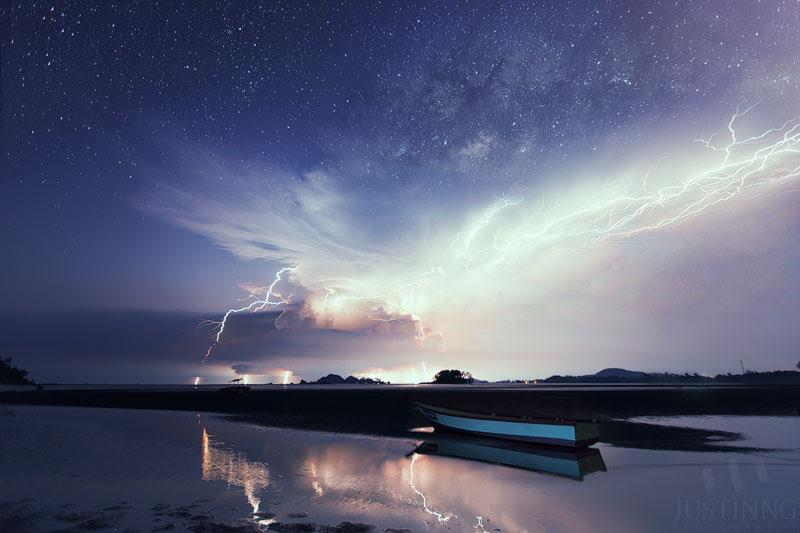 Milky Way rising above spectacular lightning display