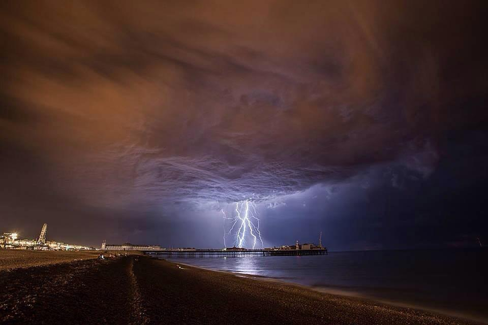 Brighton Pier is the centre of a lightning storm.