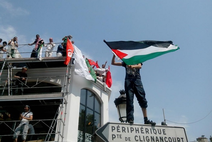 Parisians take part in a protest in support of Palestinians.