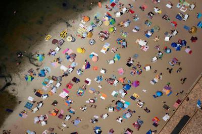 People sunbathe on the beach at Wannsee, near Berlin