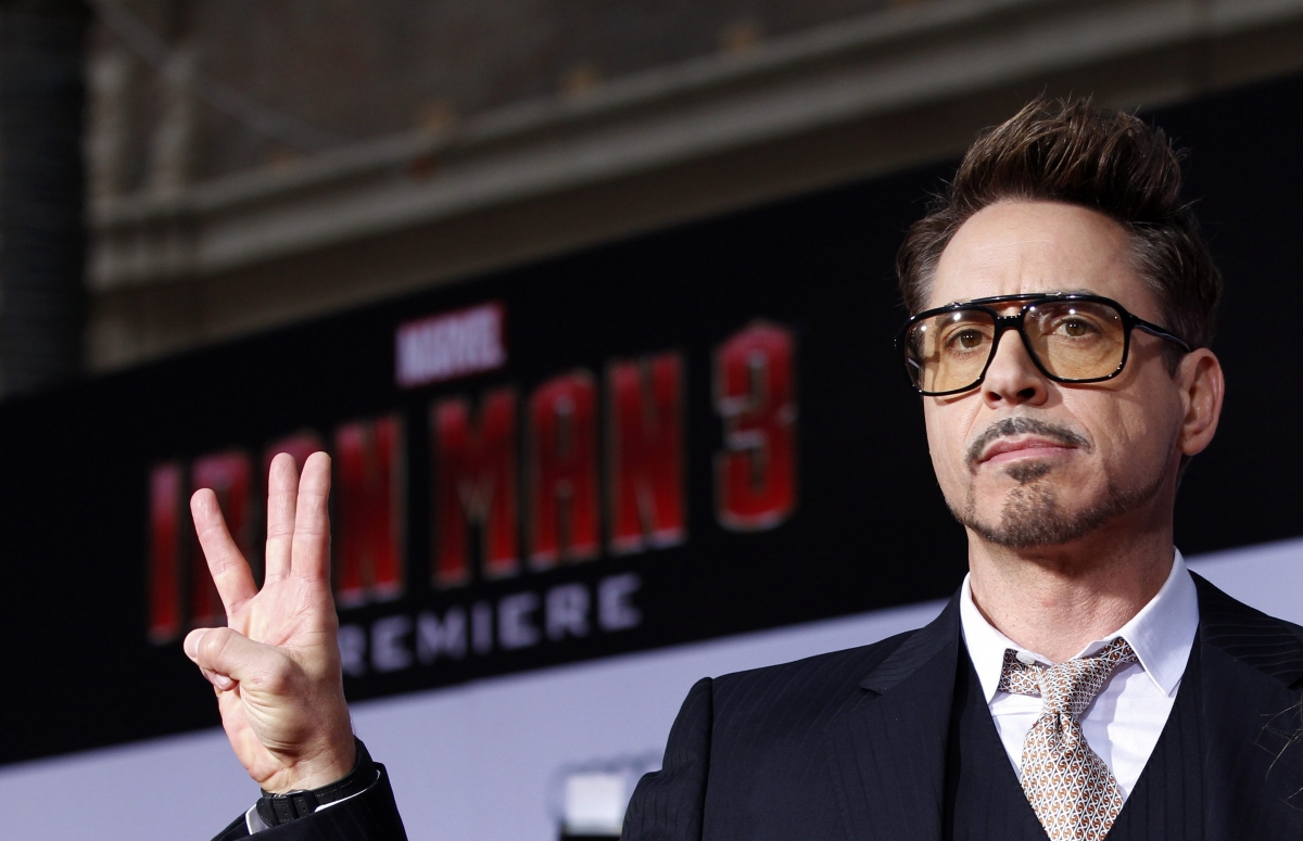 Robert Downey Jr. poses at the premiere of Iron Man 3