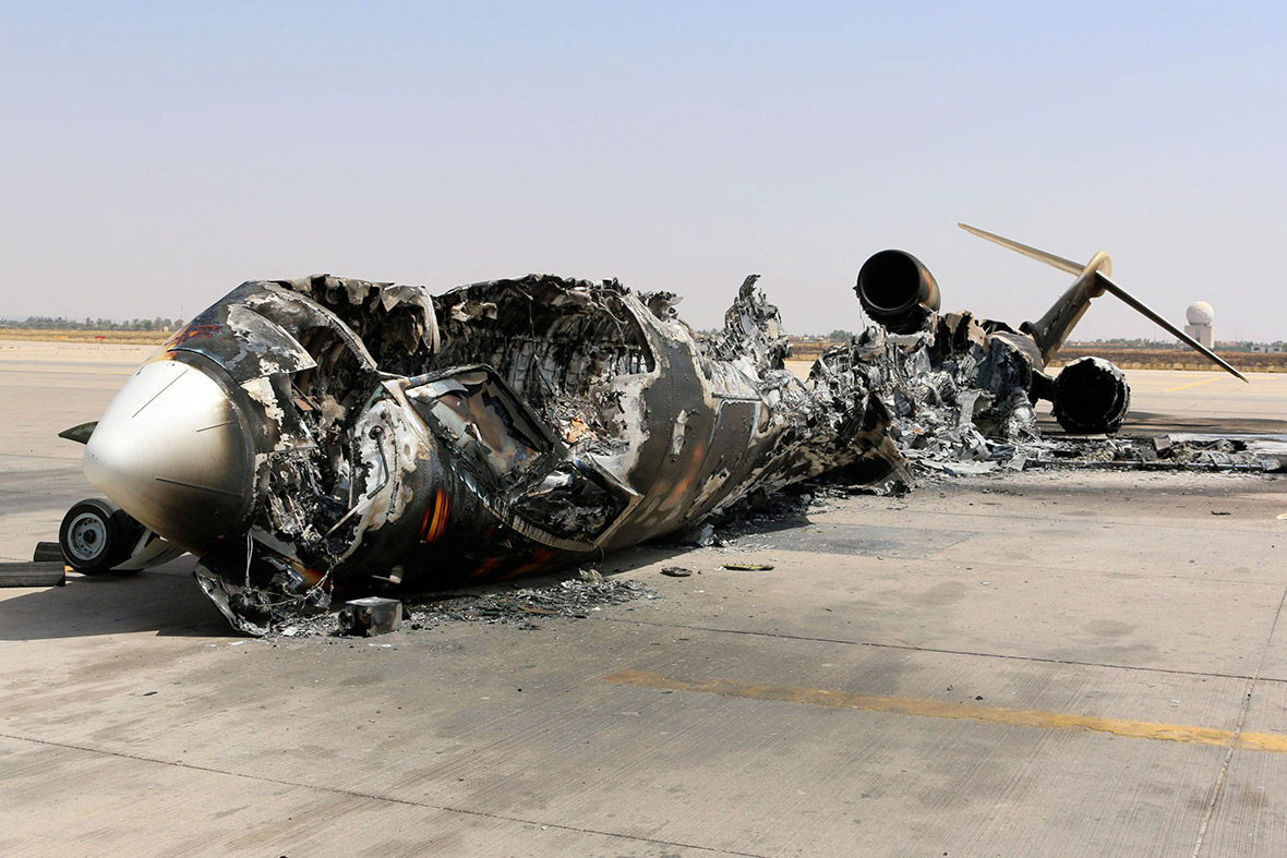 Libya burnt out planes litter runway as battle for tripoli airport 0721 tripoli airport publicscrutiny Images