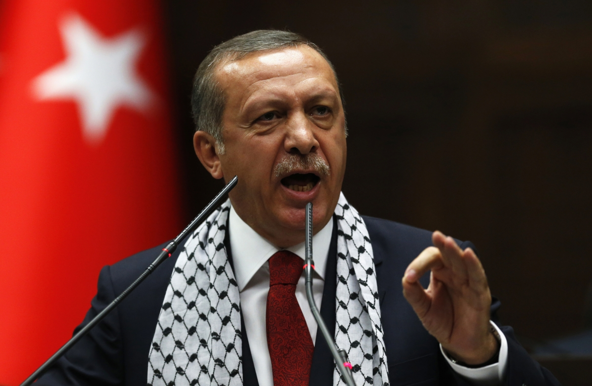 Turkey's Prime Minister Tayyip Erdogan addresses members of parliament from his ruling AK Party (AKP) during a meeting at the Turkish parliament in Ankara