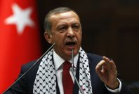 Turkey\'s Prime Minister Tayyip Erdogan addresses members of parliament from his ruling AK Party (AKP) during a meeting at the Turkish parliament in Ankara