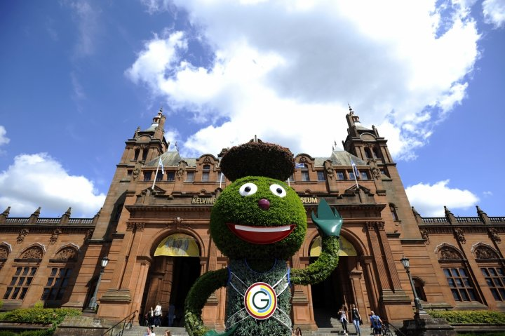 2014 Commonwealth games mascot Clyde Thistle stands outside the Kelvingrove Museum and Art Gallery