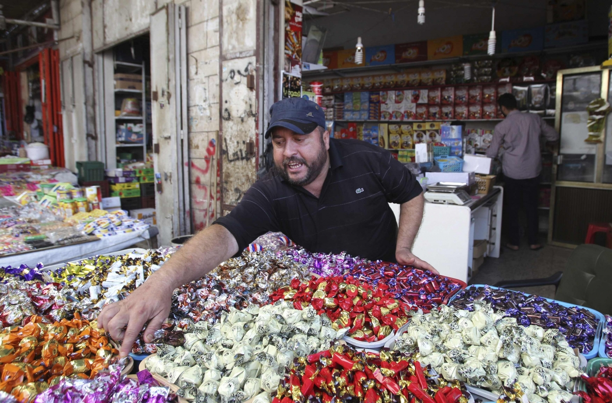 Palestinian vendor sells sweets