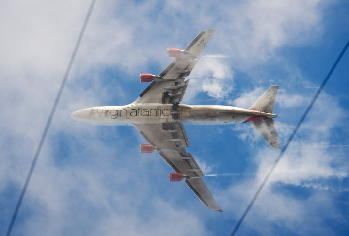 A virgin Atlantic flight was forced to make an emergency landing after cocaine pellets burst in a drugs mule's stomach.