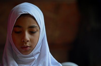 Kashmiri Muslim Woman At Prayer Before Eid
