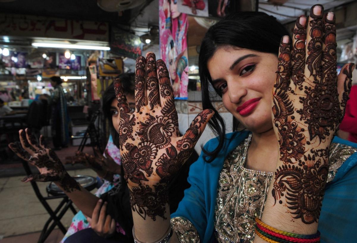 Pakistani Woman Henna Decorated Hands
