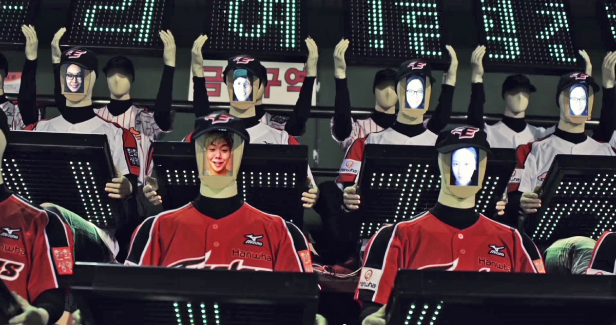 The faces of fans watching the game remotely are displayed on the robots