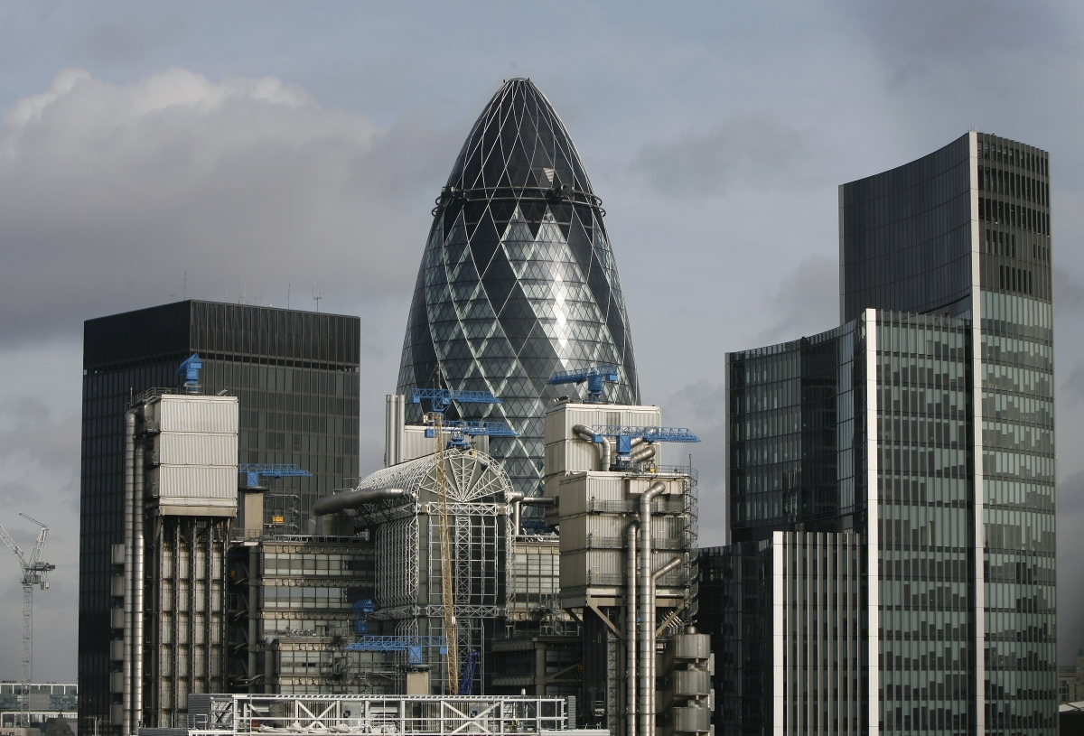 """Sunlight is reflected from Norman Foster's """"Gherkin"""" as it stands among other buildings in the City of London"""