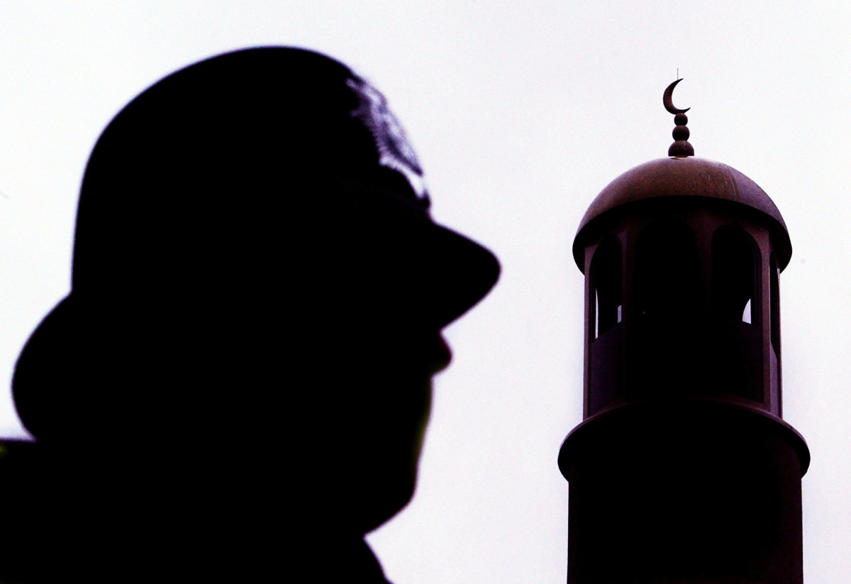 A police officer stands guard outside Finsbury Park mosque following a raid in north London, January 20, 2003