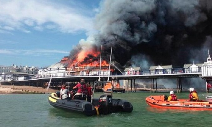 Fire is raging at Eastbourne Pier in in East Sussex