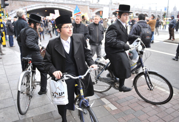 Three Orthodox Jews on their bicycle