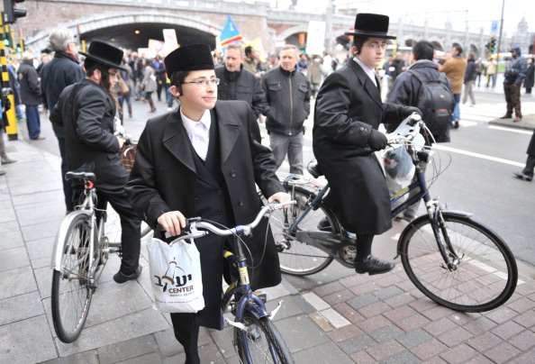 Three Orthodox Jews on their bicycle