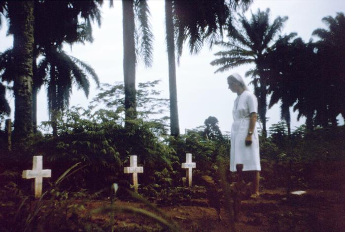 Nun visits graves of Ebola victims (Zaire (now Democratic Republic of Congo), 1976)
