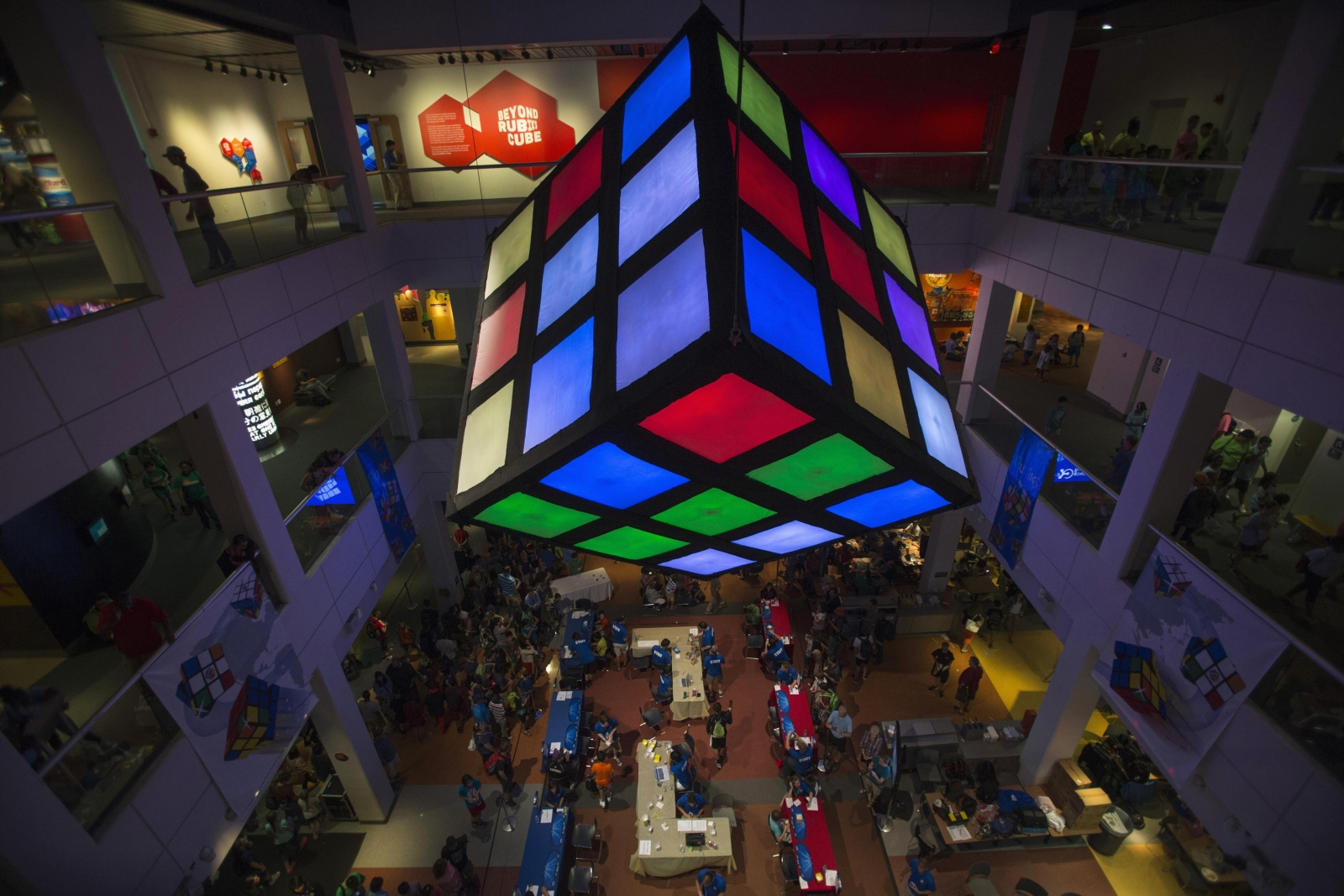 Rubiks Cube looks down over the crowd of participants