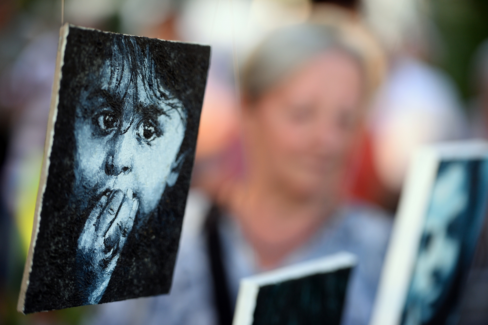 Painting of a Roma baby is on display at the open-air exhibition in Nehru Park in Budapest