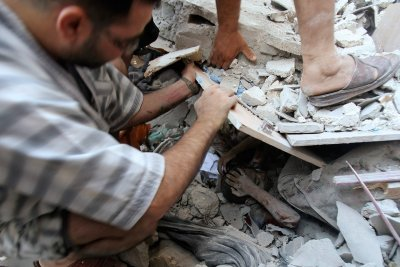 gaza boy rubble