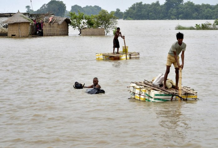 A nine-month pregnant woman swam about 600 meters of Krishna river, to ensure medical help for her unborn baby.
