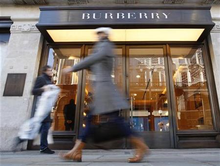 Pedestrians walk past a Burberry shop in London.
