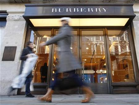 Pedestrians walk past a Burberry shop in London.