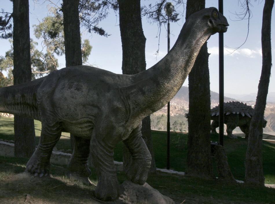 Baby titanosaurus (L) and ankylosaurus