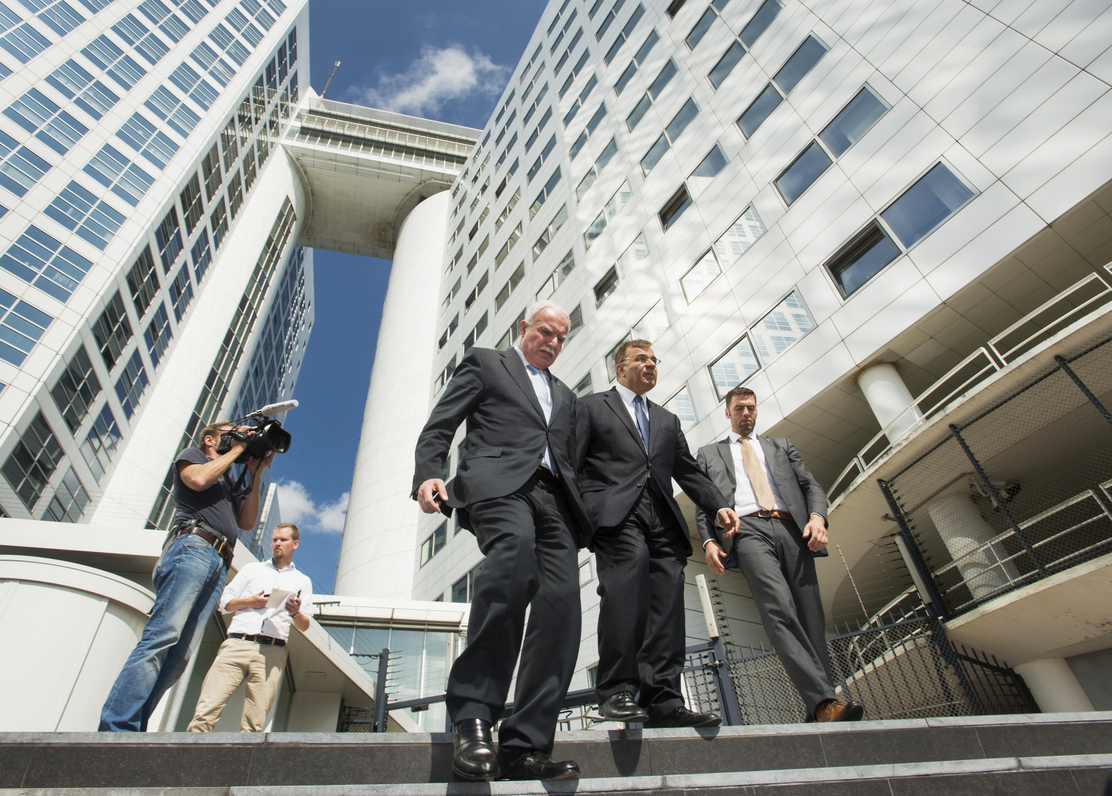 Palestinian Foreign Minister Riad al-Malki (C) leaves the International Criminal Court (ICC) at the Hague