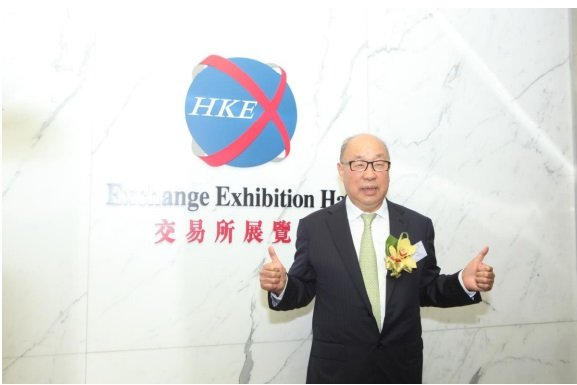 Wan Long, Chairman and Chief Executive Officer of WH Group, photographed at the  Stock Exchange of Hong Kong, toasting to the success of stock prices on the first trading day.