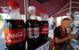 Coca-Cola bottles are seen on sale in central St. Petersburg, August 6, 2014. Coca-Cola Co confirmed on Wednesday it had taken advertisements off four Russian television channels