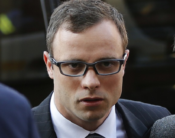 Oscar Pistorius arrives at court to hear Gerrie Nel attack his credibility  during heads of argument