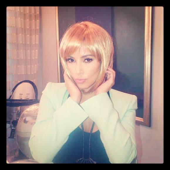 Kim Kardashian in blonde wig.