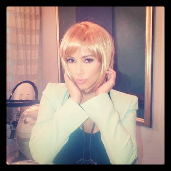 Kim Kardashian in blonde wig.