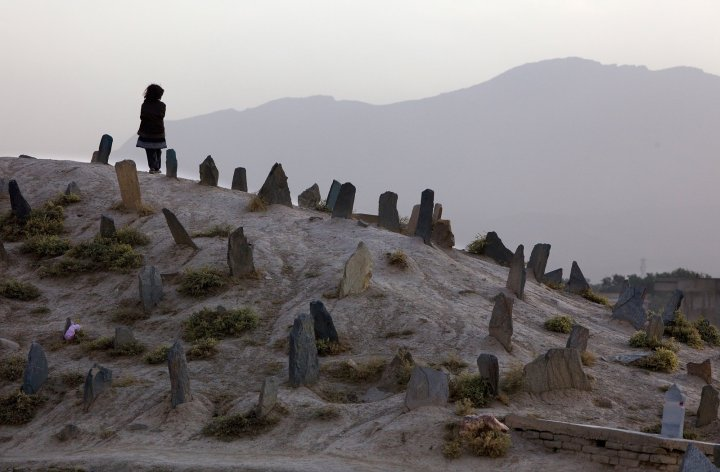 Child in a graveyard in rural pakistan (Getty Paula Bronstein)