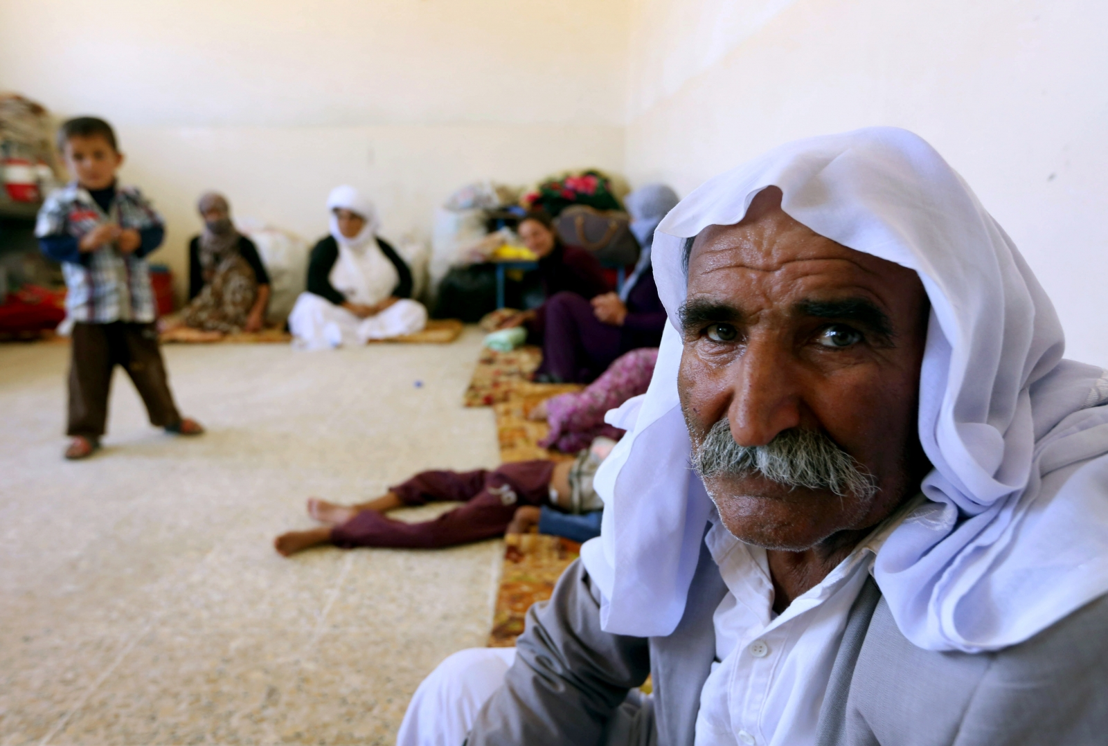 Yazidi families are fleeing the bloodshed and violence in the northern Iraqi town of Sinjar.