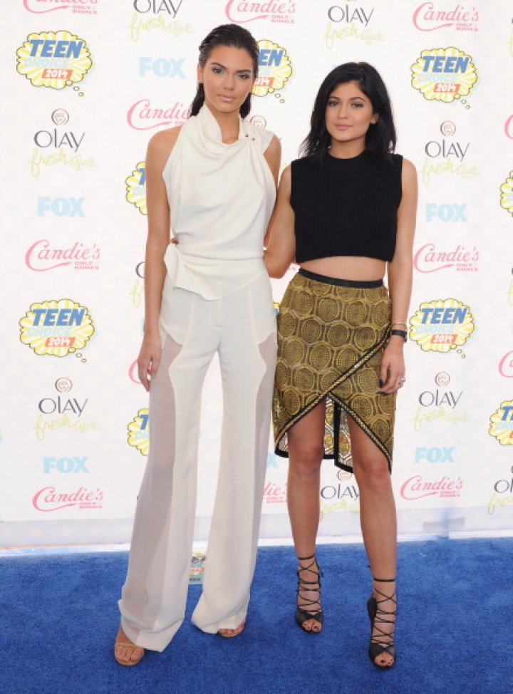 Kendall Jenner and sister Kylie Jenner arrive at the 2014 Teen Choice Awards at The Shrine Auditorium on August 10, 2014 in Los Angeles, California.