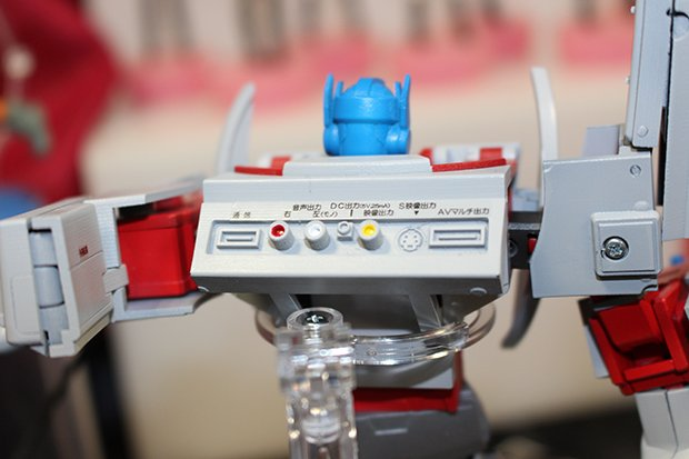 The back of Optimus Prime's body features vintage RGB cable and scart ports