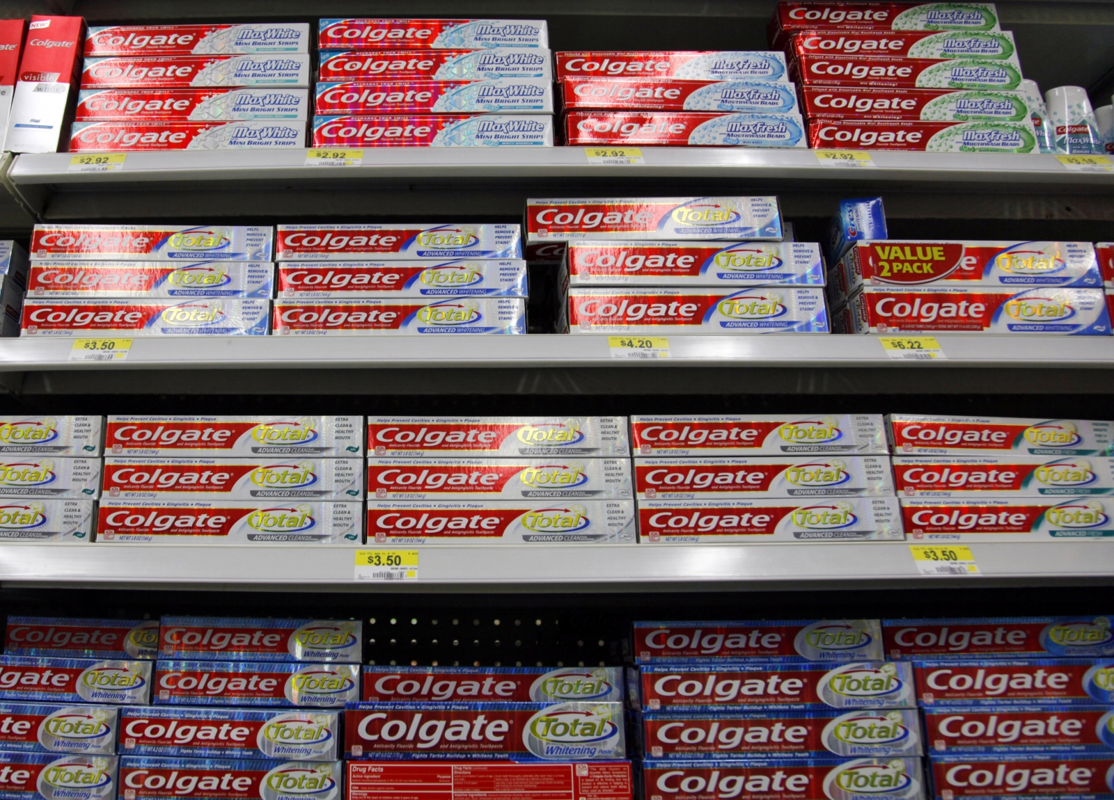 Boxes of Colgate toothpaste are displayed on store shelves in Westminster, Colorado