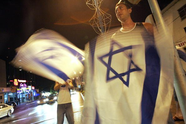 Israeli youths display their country's flag in Haifa (Yoav Lemmer AFP/Getty)