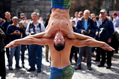 Edinburgh Festival Fringe entertainers perform on the Royal Mile