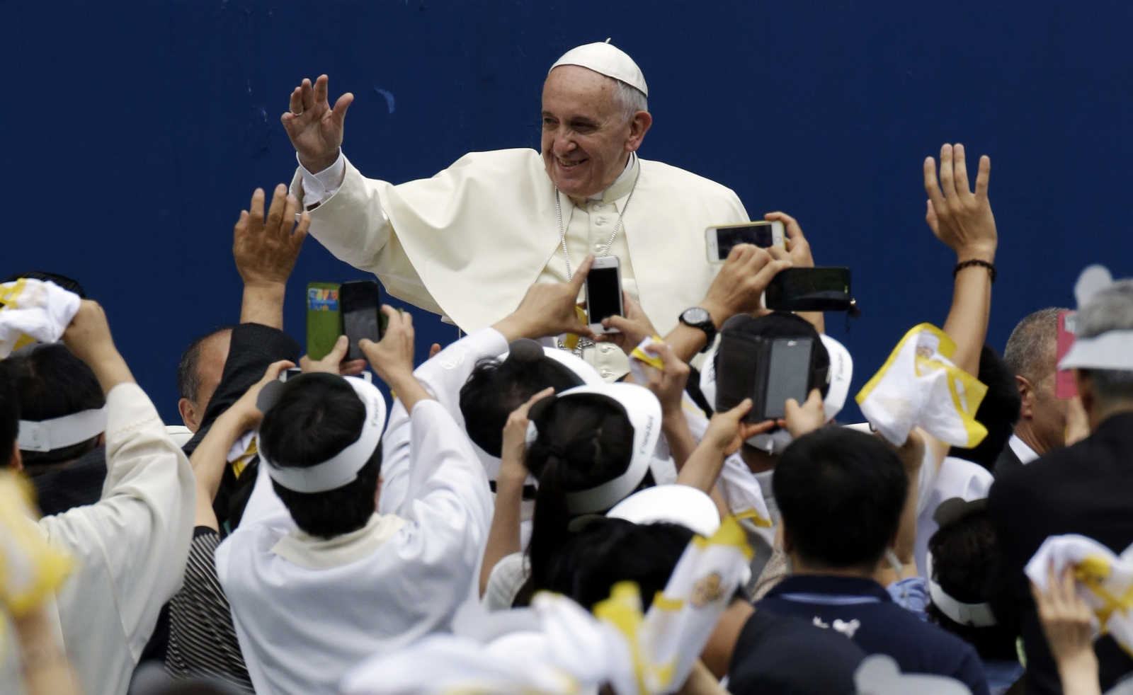 Pope Francis is greeted by the faithful upon his arrival for the Holy Mass at Daejeon World Cup stadium in Daejeon