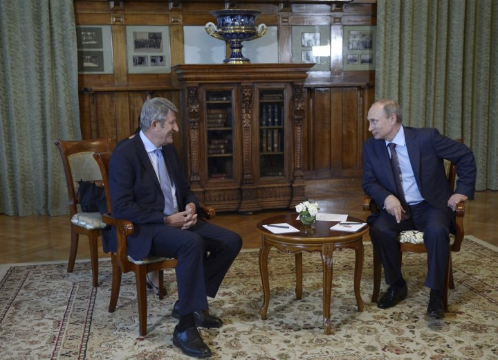 Russian President Vladimir Putin (R) meets with French businessman Philippe de Villiers in Yalta, Crimea,
